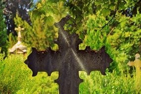 metal cross at the cemetery religion