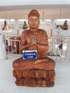 buddha statue in building, wood carving