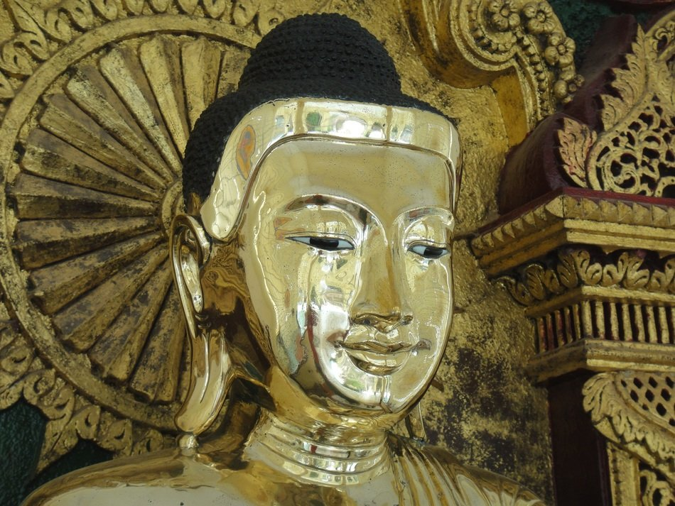 gold covered Buddha face