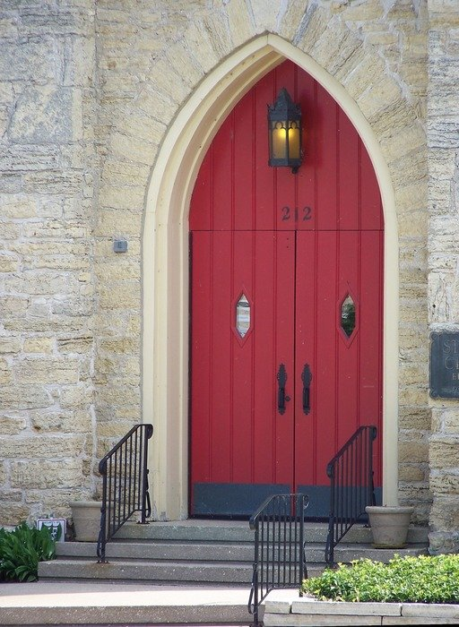 Red door in a church
