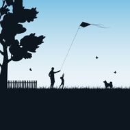 Father and child play with kite N2