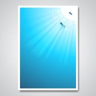 Diver in sea and sun rays pass through the water