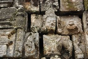buddha statue on a temple wall in Indonesia