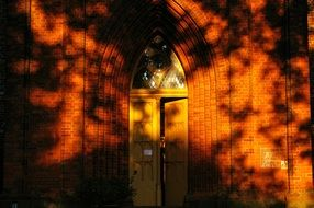 The doors of the chapel in the glare of the setting sun
