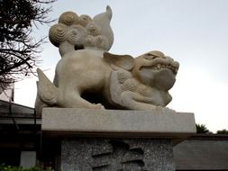 stone guardian dogs near the temple in japan