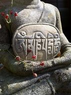 Stone figure of buddha in relaxation
