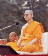 Buddhist leader at the microphone