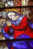 Virgin Mary on colorful stained glass in a church
