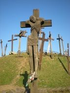 statue of a man on a cross on a hill