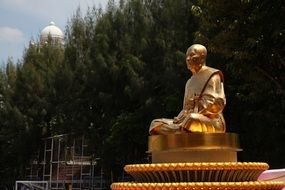 golden monk meditate statue