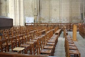 rows of wooden chairs in a church