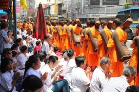 Walking Buddhist monks at the ceremony