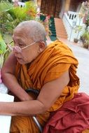 Old Buddhist monk in glasses
