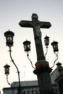 A monument to Christ and five lanterns in Cordoba close-up