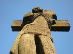 wooden statue of a man on the cross