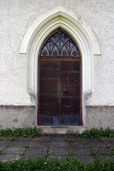 old arched entrance door