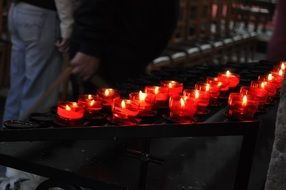 burning wax candles in the temple
