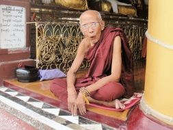 An elderly Buddhist monk in the temple