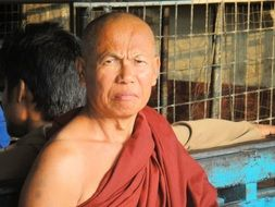 Monk Buddhist with a thoughtful look