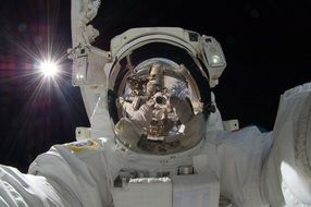 astronaut spacewalk iss tools suit
