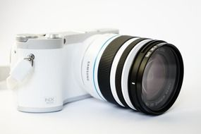 White camera with zoom lens