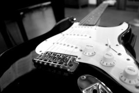 black and white photo of an electric guitar close up