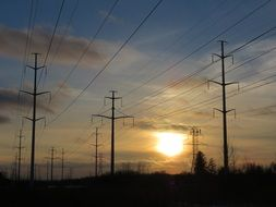 twilight over power lines among nature in canada