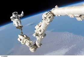 astronaut spacewalk iss arm tools