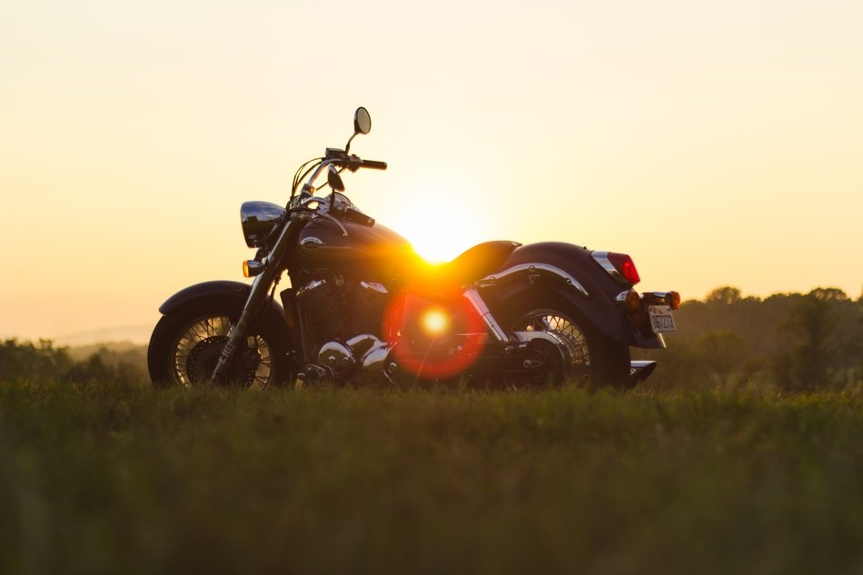 retro styled motorbike on a sunset