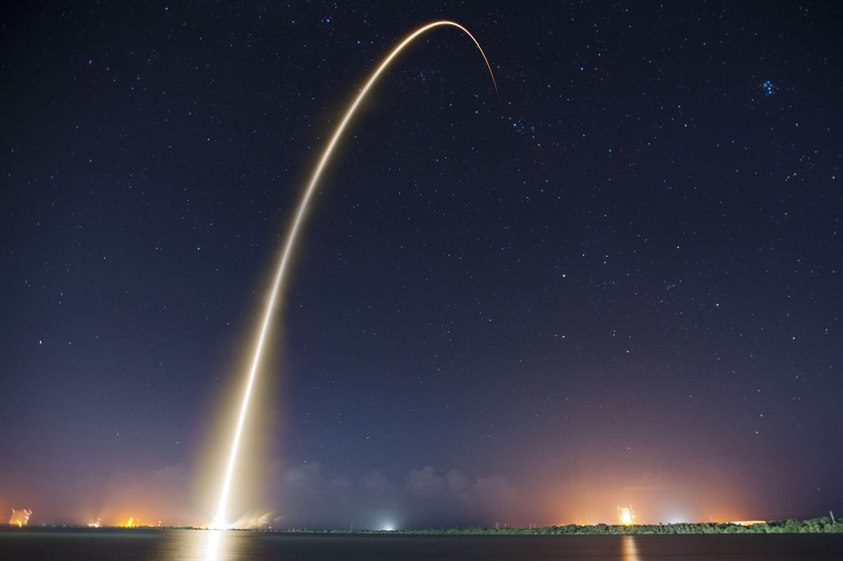 rocket launch trajectory at night sky