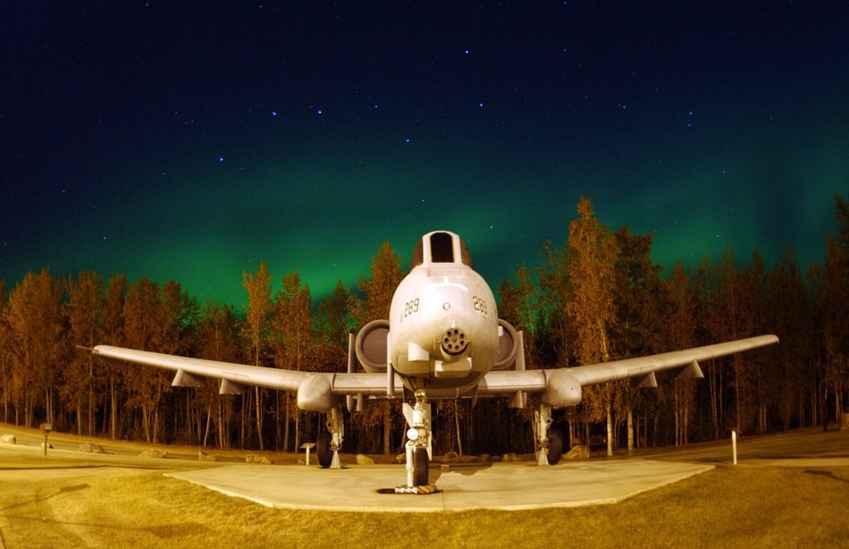 military planes on the background of the polar night in Alaska