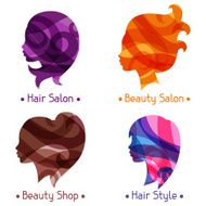 Women silhouettes emblems of beauty or hairdressing salon N2