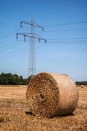 transmission tower on the agricultural field