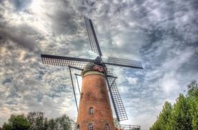 Windmill on the background of a cloudy sky