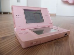 old pink nintendo device
