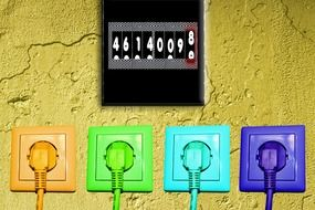 multi-colored sockets on a yellow wall