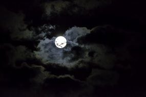 bright moon in a black sky