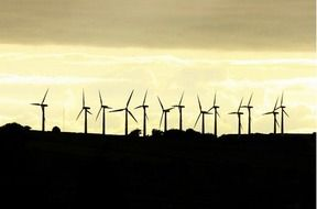 Silhouettes of wind turbines as a graphic image