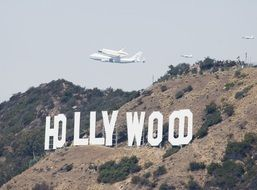 space shuttle over the Hollywood sign
