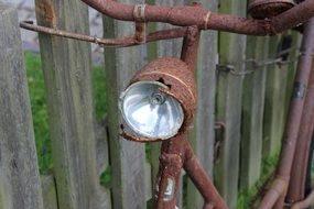 Rusty bicycle with lamp
