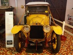 yellow oldtimer aautomobile in historical museum