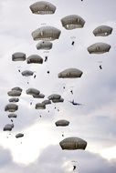 parachute training in the grey sky