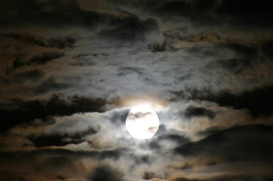 full moon in the night clouds