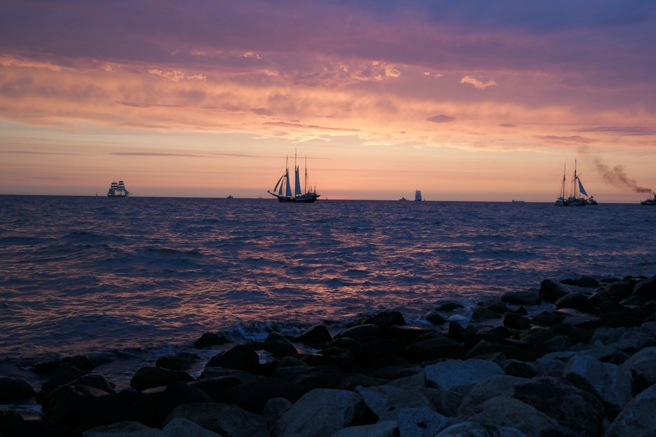 sailing ships on the Baltic Sea at sunset
