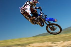 dirt bike racer racing jump air