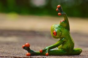 funny frog doing gymnastics