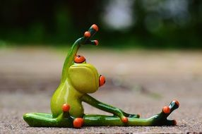 toy frog is engaged in gymnastics