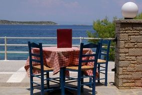 table on a terrace in a tavern on a greek island