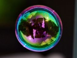 Colorful soap bubble with a mirror image