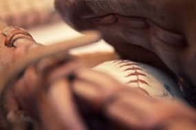 ball in a baseball glove closeup